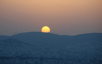 Sunset over Athens suburbs